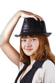 Young red pretty woman in black cap isolated — Stock Photo