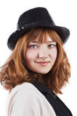 Young smiling pretty woman in black cap isolated — Stock Photo