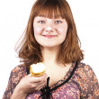 Portrait of funny expressive girl eating ice-cream isolated — Stock Photo #9707370