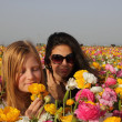 Two Girl at the flowers — Stock Photo
