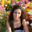 Stock Photo: Beautiful Jewish Girl at colored flowers