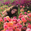 Beautiful Girl at the flowers — Stock Photo