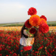 Girl gives you a bunch of field flowers. Focus on a bouquet. Small DOF — Foto de Stock