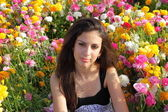 Beautiful Jewish Girl at the colored flowers — Stock Photo
