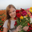 Girl on Colored Flower field — Stock Photo