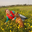 Foto Stock: Girl with dog on grass