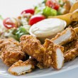 Chicken Strips With Country Potatoes - Stock Photo