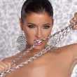 Beauty Woman bite chain - Stock Photo