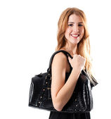 Smiling cute girl with black handbag — Stock Photo