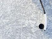 Hockey stick and puck — Stock Photo