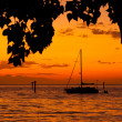 Foto Stock: Sailboat at sunset