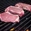 Steaks on barbecue - Stock Photo