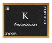 Isolated blackboard with periodic table, Potassium. — Stock Photo