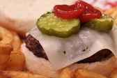 Juicy Cheeseburger with Pickles and Ketchup — Stock Photo