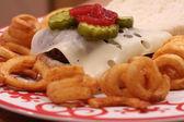 Juicy Cheeseburger with Ketchup and Pickles — Stock Photo