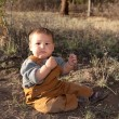 Baby boy in early spring nature - Stock Photo