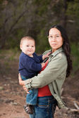Mother and baby in nature — Stock Photo