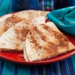 Sweet tortilla dessert with cinnamon - Stock Photo