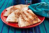 Sweet tortilla dessert with cinnamon — Stock Photo
