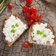 Goat cheese on bread - Stock Photo