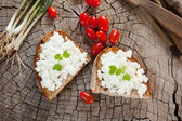 Goat cheese on bread — Stock Photo