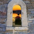Traditional boat in lake through an old door in Crete island, Greece — Stock Photo