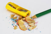 Green pencil with yellow scraper — Stock Photo