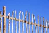 Wooden fence on blue sky — Stock Photo