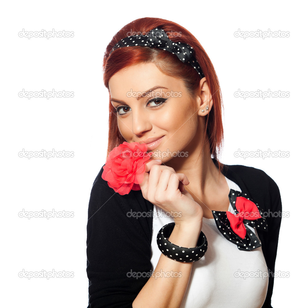 Portrait of a beautiful young red head woman with hair accesories, isolated on white background — Stock Photo #8906987