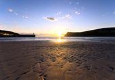 Sonnenuntergang am sandstrand in port erin - insel man — Stockfoto