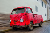 Old Wrecked Red Van Parked on Street with Blur — Stock Photo