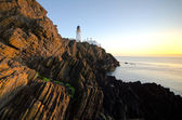 Sunrise at Douglas Lighthouse with Cliffs — Stock Photo
