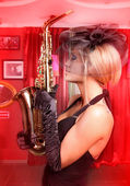 Sexy girl with saxophone — Stock Photo