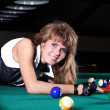 A young woman playing billiard — Stock Photo