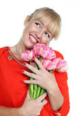 Woman with pink tulips bouquet of flowers smiling isolated on wh — Stock Photo