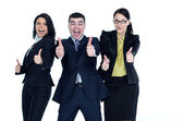 A young man and two young women with thumbs-up gesture isolated — Stock Photo