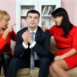Stock Photo: Two young women argue over the young man