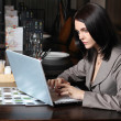 Beautiful woman with laptop in cafe — Stock Photo
