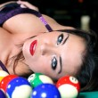 Portrait of sexy girls lying on table for game of billiard — Stock Photo #9555221