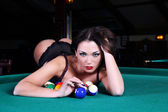 Portrait of sexy girls lying on the table for a game of billiard — Stock Photo