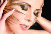 Glamourous woman face with fashion make-up. — Stock Photo