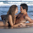 Stock Photo: Young couple relaxing on the beach