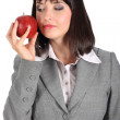 Young woman offer an apple — Stock Photo