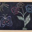 Spring drawing on blackboard — Stock Photo #8084636