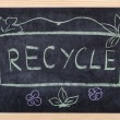 Recycle word written on blackboard - Stock Photo