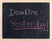 Yesterday deadline written on blackboard — Stock Photo