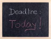 Today deadline written on blackboard — Stock Photo