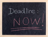 Now deadline written on blackboard — Stock fotografie
