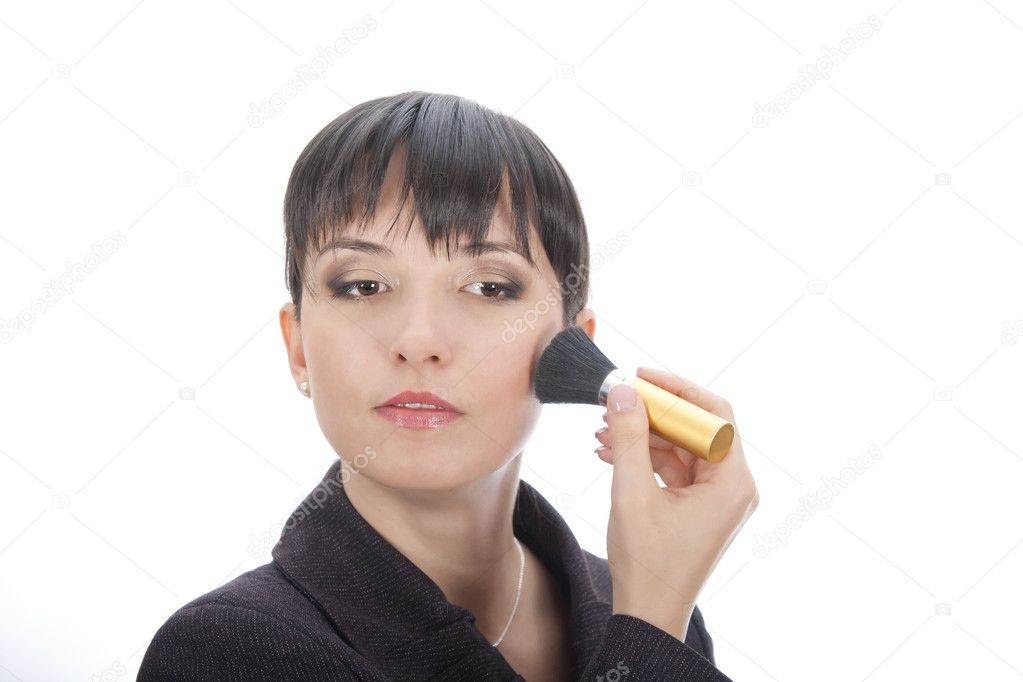 Business woman touching up her make up — Stock Photo #8080434