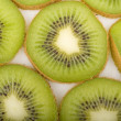 Fresh kiwi slices background — Stock Photo